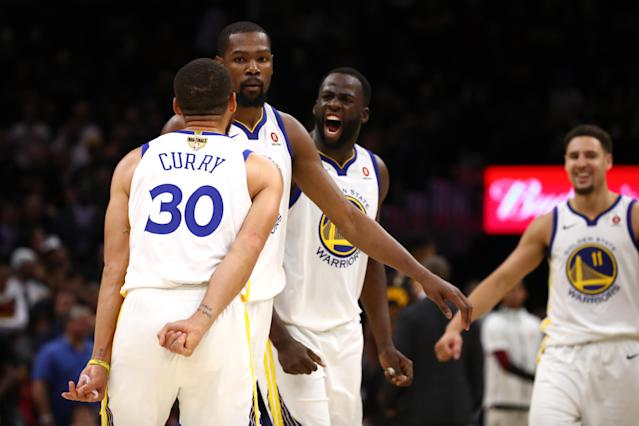 CLEVELAND, OH - JUNE 06: Stephen Curry #30 and Draymond Green #23 of the Golden State Warriors celebrate with Kevin Durant #35 against the Cleveland Cavaliers in the second half during Game Three of the 2018 NBA Finals at Quicken Loans Arena on June 6, 2018 in Cleveland, Ohio. (Photo by Gregory Shamus/Getty Images)