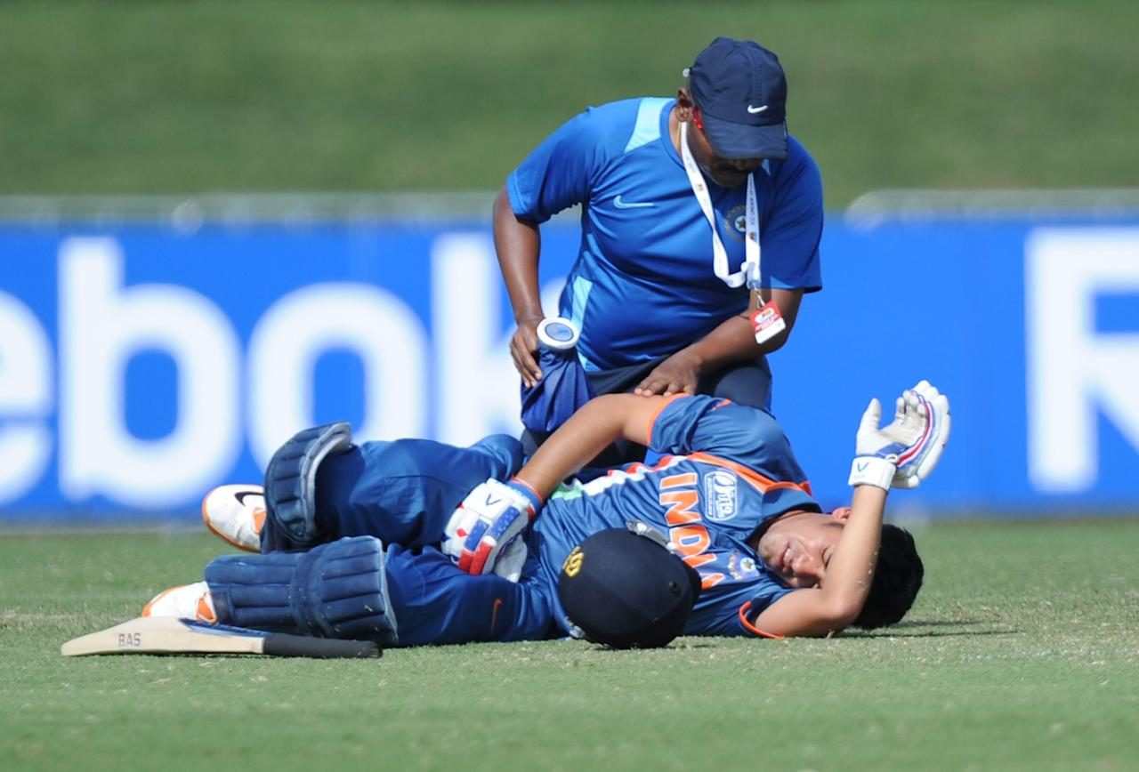 TOWNSVILLE, AUSTRALIA - AUGUST 23:  Prashant Chopra of India lays on the ground in pain after being hit in the groin by a ball from Ed Nuttall during the ICC U19 Cricket World Cup 2012 Semi Final match between India and New Zealand at Tony Ireland Stadium on August 23, 2012 in Townsville, Australia.  (Photo by Malcolm Fairclough-ICC/Getty Images)