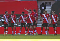 Southampton players celebrate their first goal of the goal scored by Arsenal's Gabriel Magalhaes, during the FA Cup fourth round soccer match between Southampton and Arsenal, at St. Mary's Stadium, in Southampton, England, Saturday Jan. 23, 2021. (Catherine Ivill/PA via AP)