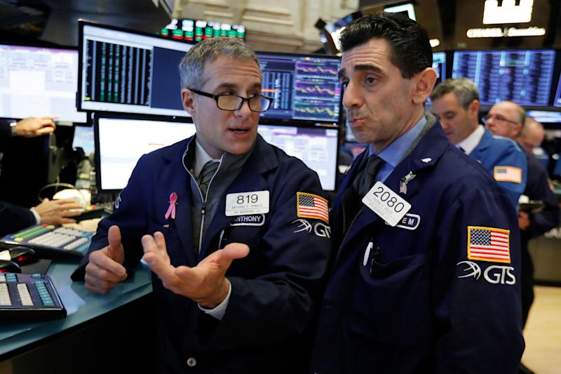 Specialists Anthony Rinaldi, left, and Peter Mazza confer as they work on the floor of the New York Stock Exchange, Friday, Jan. 4, 2019. Stocks are jumping at the open on Wall Street Friday as investors welcome news of trade talks between the U.S. and China and a big gain in jobs in the U.S. (AP Photo/Richard Drew)