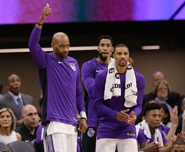 Vince Carter (L) and George Hill (R) give Kings coach Dave Joerger a couple of valuable veteran voices to help mold Sacramento's many young players. (AP)