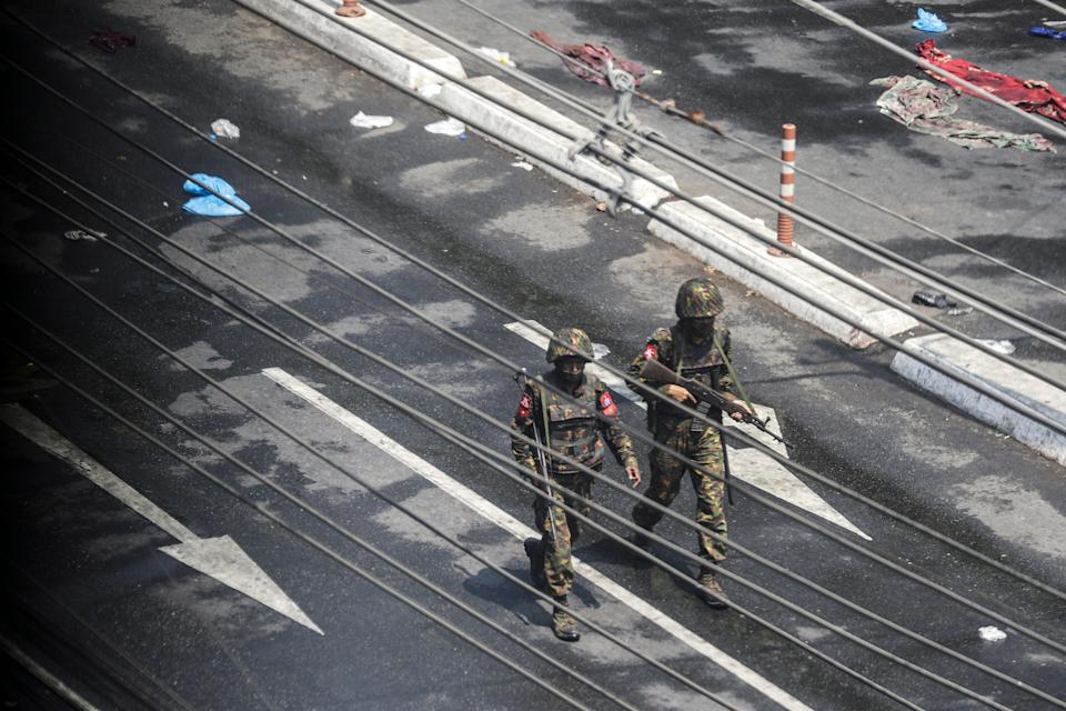 <p>Military personnel in Yangon on Tuesday</p> (EPA)
