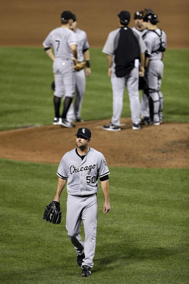Chicago White Sox starting pitcher John Danks (50) walks off the field after being relieved in the sixth inning of a baseball game against the Baltimore Orioles, Friday, Sept. 6, 2013, in Baltimore. Danks allowed two home runs in the sixth. (AP Photo/Patrick Semansky)