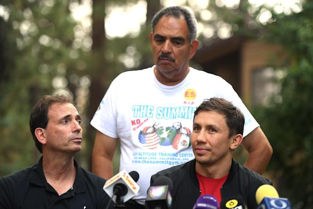 Gennady Golovkin (R) speaks to the media as he is joined by promoter Tom Loeffler (L) and trainer Abel Sanchez during a news conference on Aug. 9, 2018 in Big Bear Lake, California. (Getty Images)