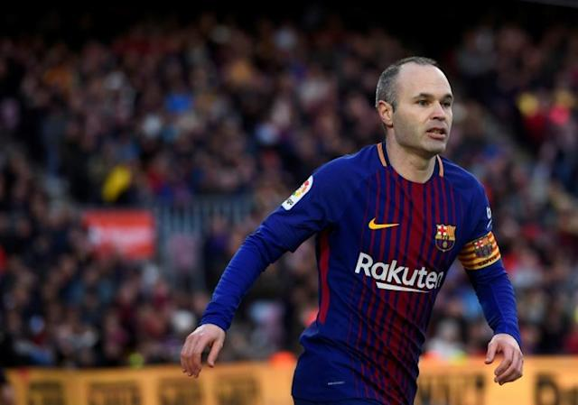Barcelona's midfielder Andres Iniesta looks on during the Spanish league football match against Getafe February 11, 2018