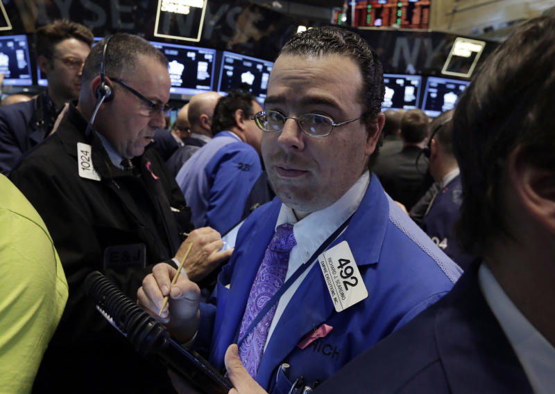 """Trader Richard Scardino, right, works on the floor of the New York Stock Exchange, Wednesday, March 26, 2014. The stock market opened higher Wednesday after a strong report on American manufacturing. The maker of the hit game """"Candy Crush Saga"""" flopped in its market debut.(AP Photo/Richard Drew)"""
