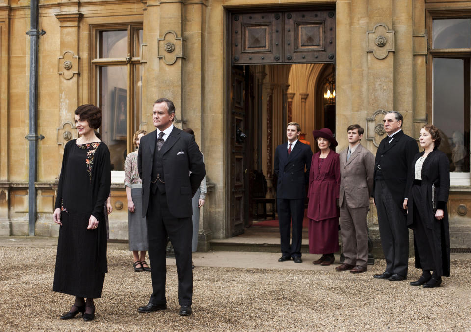 "This undated publicity photo provided by PBS shows, from left, Elizabeth McGovern as Lady Grantham, Hugh Bonneville as Lord Grantham, Dan Stevens as Matthew Crawley, Penelope Wilton as Isobel Crawley, Allen Leech as Tom Branson, Jim Carter as Mr. Carson, and Phyllis Logan as Mrs. Hughes, from the TV series, ""Downton Abbey."" As PBS' ""Masterpiece"" marks its 50th anniversary Sunday, the drama and mystery showcase could rest on its reputation built with acclaimed programs including ""I, Claudius"" and ""Elizabeth R"" and polished anew by surprising pop-culture hits ""Sherlock"" and ""Downton Abbey."" (Nick Briggs/PBS, Carnival Film & Television Limited 2012 for MASTERPIECE via AP)"
