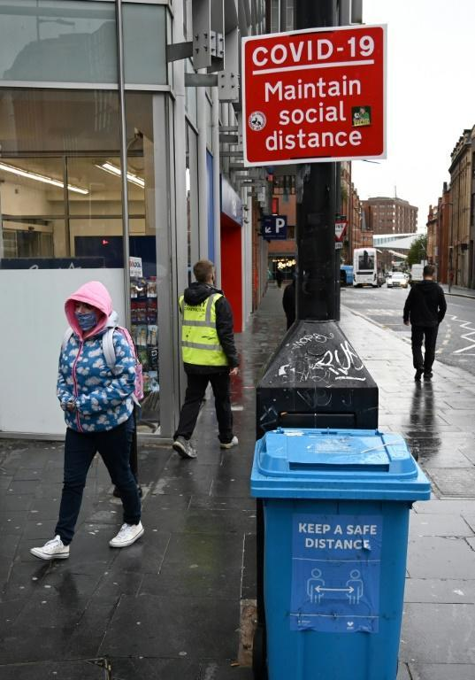 """A street sign advises members of the public to """"Maintain Social Distance"""" in Liverpool"""