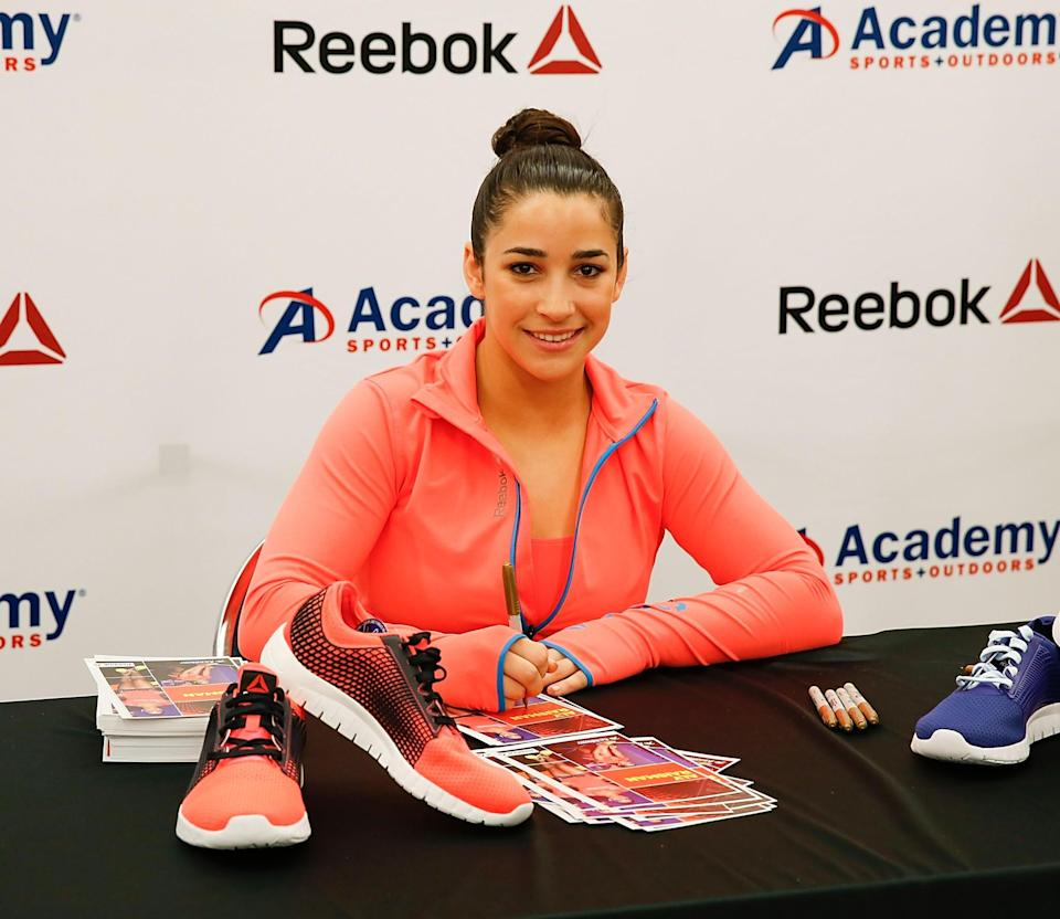 <p>She made a variety of appearances ranging from Academy Sports to Pandora jewelry. (Getty) </p>