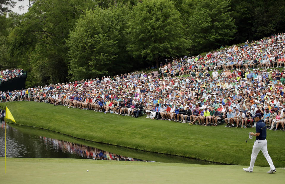 FILE - Jordan Spieth waits to putt on the 16th hole during the fourth round of the Masters golf tournament in Augusta, Ga., in this Sunday, April 12, 2015, file photo. The hole is one of the largest gathering spots on the course. For this Masters in November, there will be no spectators. (AP Photo/Matt Slocum, File)
