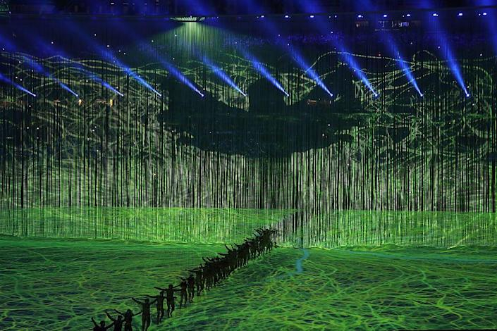 """<p>Dancers at the opening ceremony in Rio de Janeiro performed <em>Pindorama: Birth of Life</em>, an <a href=""""https://library.olympics.com/Default/digitalCollection/DigitalCollectionInlineDownloadHandler.ashx?documentId=172606&_cb=1528502400"""" rel=""""nofollow noopener"""" target=""""_blank"""" data-ylk=""""slk:artful performance"""" class=""""link rapid-noclick-resp"""">artful performance</a> representing the beginnings of Brazil. </p>"""