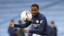 Manchester City's Raheem Sterling kicks the ball during warmup before the English Premier League soccer match between Manchester City and Arsenal at the Etihad stadium in Manchester, England, Saturday, Oct. 17, 2020. (Alex Livesey/Pool via AP)