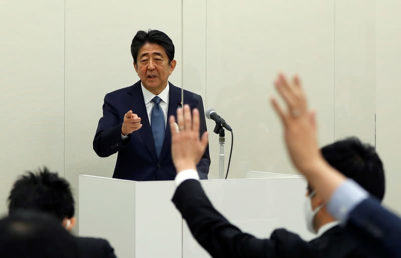 FILE PHOTO: Former Japanese PM Shinzo Abe holds a news conference in Tokyo
