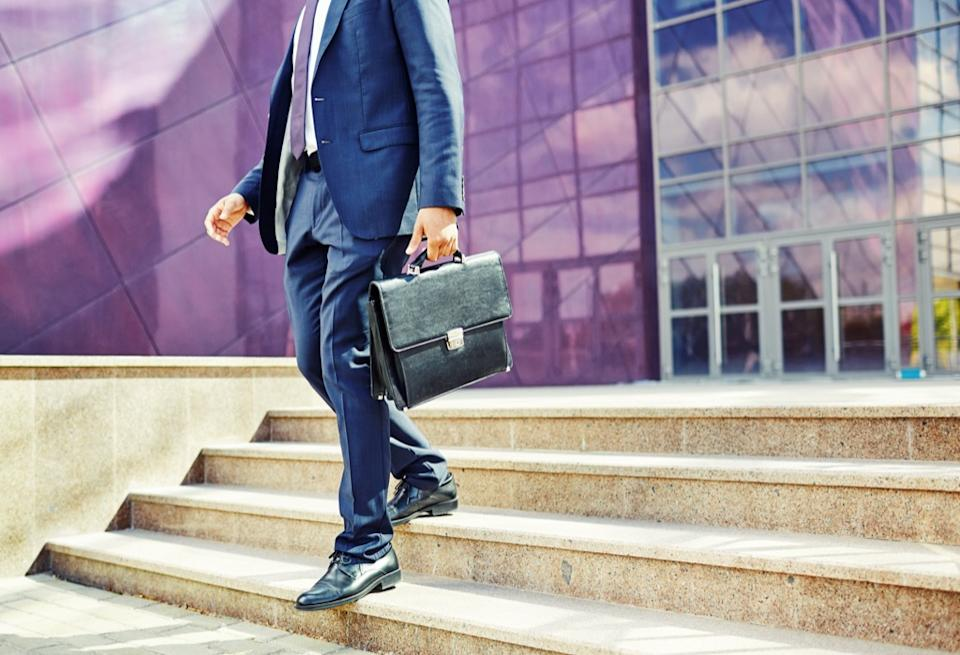 man with a briefcase on steps