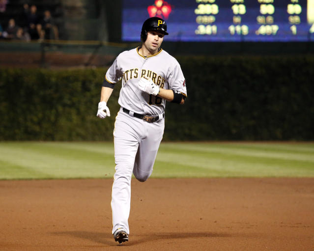 Pittsburgh Pirates' Neil Walker rounds the bases after hitting a home run off Chicago Cubs starting pitcher Jeff Samardzija during the first inning of a baseball game Monday, Sept. 23, 2013, in Chicago. (AP Photo/Charles Rex Arbogast)