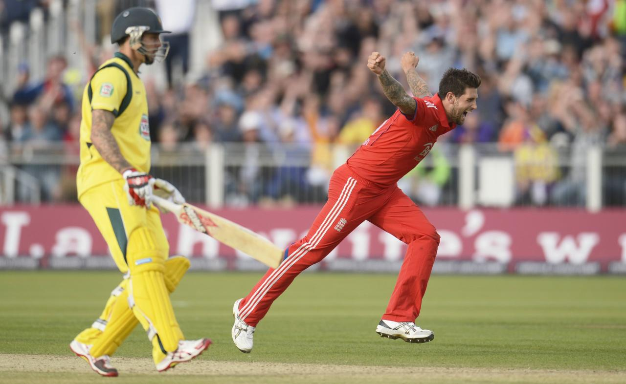 England's Jade Dernbach celebrates after dismissing Australia's James Faulkner (not in picture) as Mitchell Johnson (L) looks on during the second T20 international at the Riverside cricket ground in Chester-le-Street, near Durham, August 31, 2013. REUTERS/Philip Brown (BRITAIN - Tags: SPORT CRICKET)