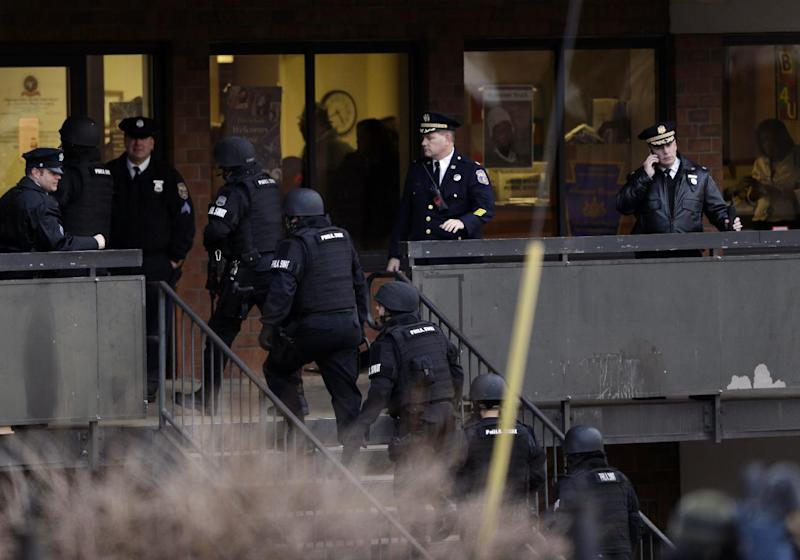 Police enter the Delaware Valley Charter School Friday, Jan. 17, 2014, in Philadelphia. Police say two students have been shot at a Philadelphia high school. (AP Photo/Matt Rourke)
