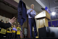 Former Vice President and Democratic presidential candidate Joe Biden tosses his jacket off stage as he begins to speak during a rally at the Teamster Local 249 Hall in Pittsburgh, Monday, April 29, 2019. (AP Photo/Gene J. Puskar)