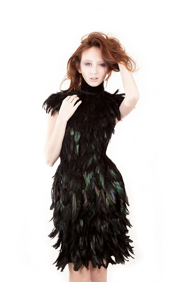 """This undated image released by Christian Fashion Week shows a model wearing a black feather dress designed by Julia Chew. Chew, 18, who recently graduated after being homeschooled by her parents, said her collection was inspired by nature. She's also been """"obsessed"""" with feathers recently and crafted a stunning above-the-knee length dress entirely of dyed black feathers. Christian Fashion Week will kick off Friday and Saturday, Feb. 8-9 in Tampa, Fla.  (AP Photo/Christian Fashion Week)"""