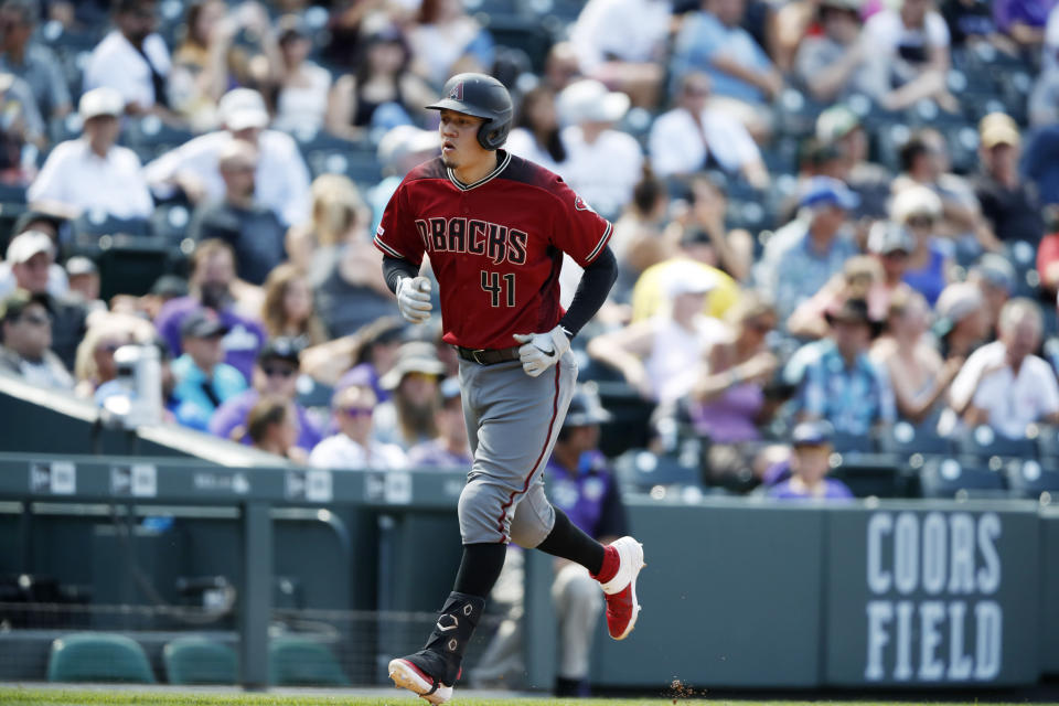 Arizona Diamondbacks' Wilmer Flores circles the bases after hitting a solo home run off Colorado Rockies starting pitcher Kyle Freeland in the sixth inning of a baseball game Wednesday, Aug. 14, 2019, in Denver. (AP Photo/David Zalubowski)