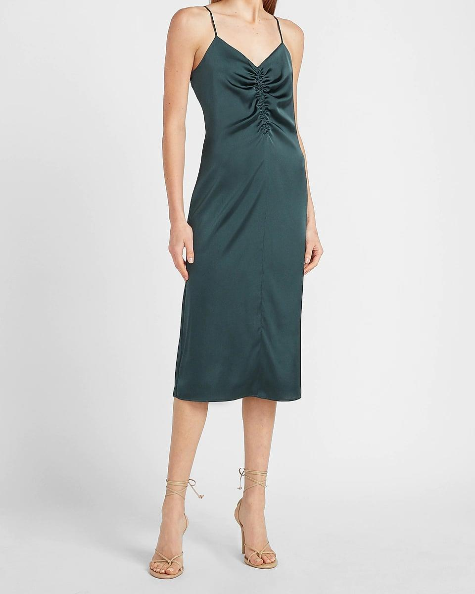 <p>You will look and feel fabulous in this <span>Express Satin Ruched Front Slip Dress</span> ($70, originally $88). From the ruched to the length, everything about it feels tasteful and fashionable.</p>