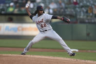 Detroit Tigers pitcher Jose Urena throws to an Oakland Athletics batter during the first inning of a baseball game in Oakland, Calif., Friday, April 16, 2021. (AP Photo/Jed Jacobsohn)