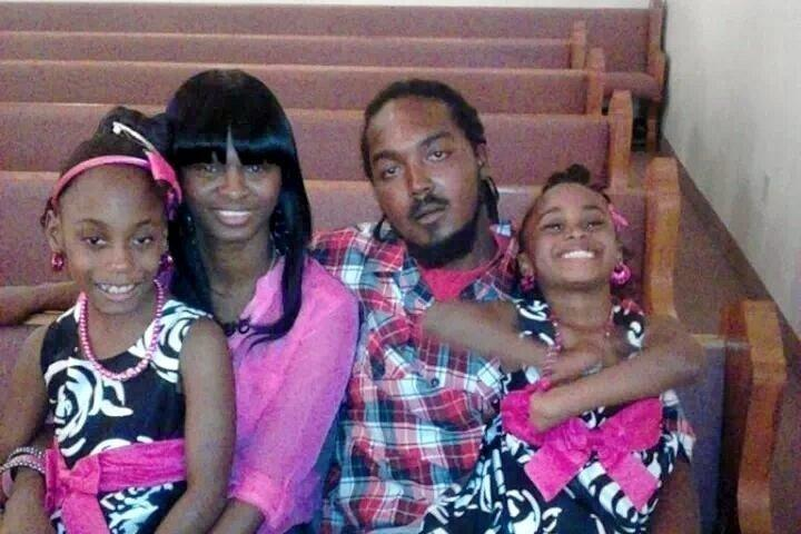 Gregory Hill Jr. with fiancée Monique Davis and two ofhis daughters. A sheriff'sdeputy killed him in his garage in 2014, and his family has been awarded 1 percent of $4 in damages. (GoFundMe)