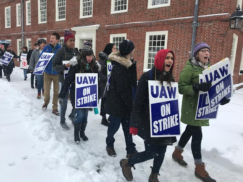 Graduate student workers at Harvard University picket at Harvard Yard Tuesday as they go on strike seeking better pay, health care coverage and protections.