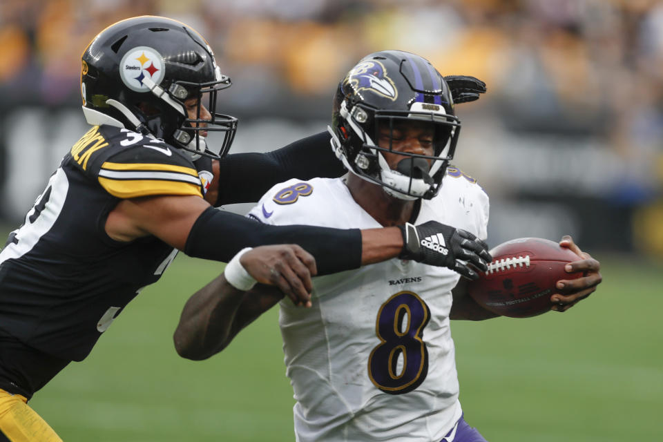 Pittsburgh Steelers free safety Minkah Fitzpatrick (39) tackles Baltimore Ravens quarterback Lamar Jackson (8) in a game last season. (AP Photo/Don Wright)