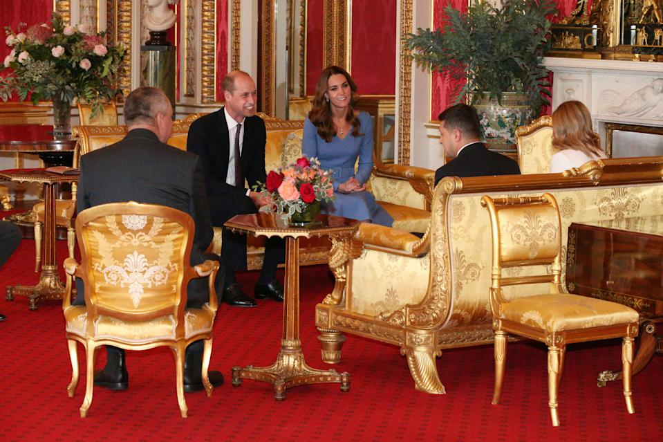 Britain's Prince William, Duke of Cambridge (2L), his wife Britain's Catherine, Duchess of Cambridge (C) talk with Ukraine's President Volodymyr Zelensky (2R) and his wife Olena (R), during an audience at Buckingham Palace in central London on October 7, 2020. (Photo by Jonathan Brady / POOL / AFP) (Photo by JONATHAN BRADY/POOL/AFP via Getty Images)