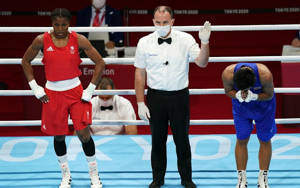 Caroline Dubois of Great Britain (left) is dejected after losing to Sudaporn Seesondee of Thailand during the Women's Light (57-60kg) Quarter final 2 at the Kokugikan Arena on the eleventh day of the Tokyo 2020 Olympic Games in Japan - PA