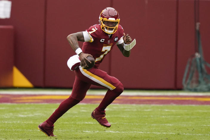 Washington Football Team quarterback Dwayne Haskins (7) runs with the ball during the first half of an NFL football game against the Seattle Seahawks, Sunday, Dec. 20, 2020, in Landover, Md. (AP Photo/Andrew Harnik)
