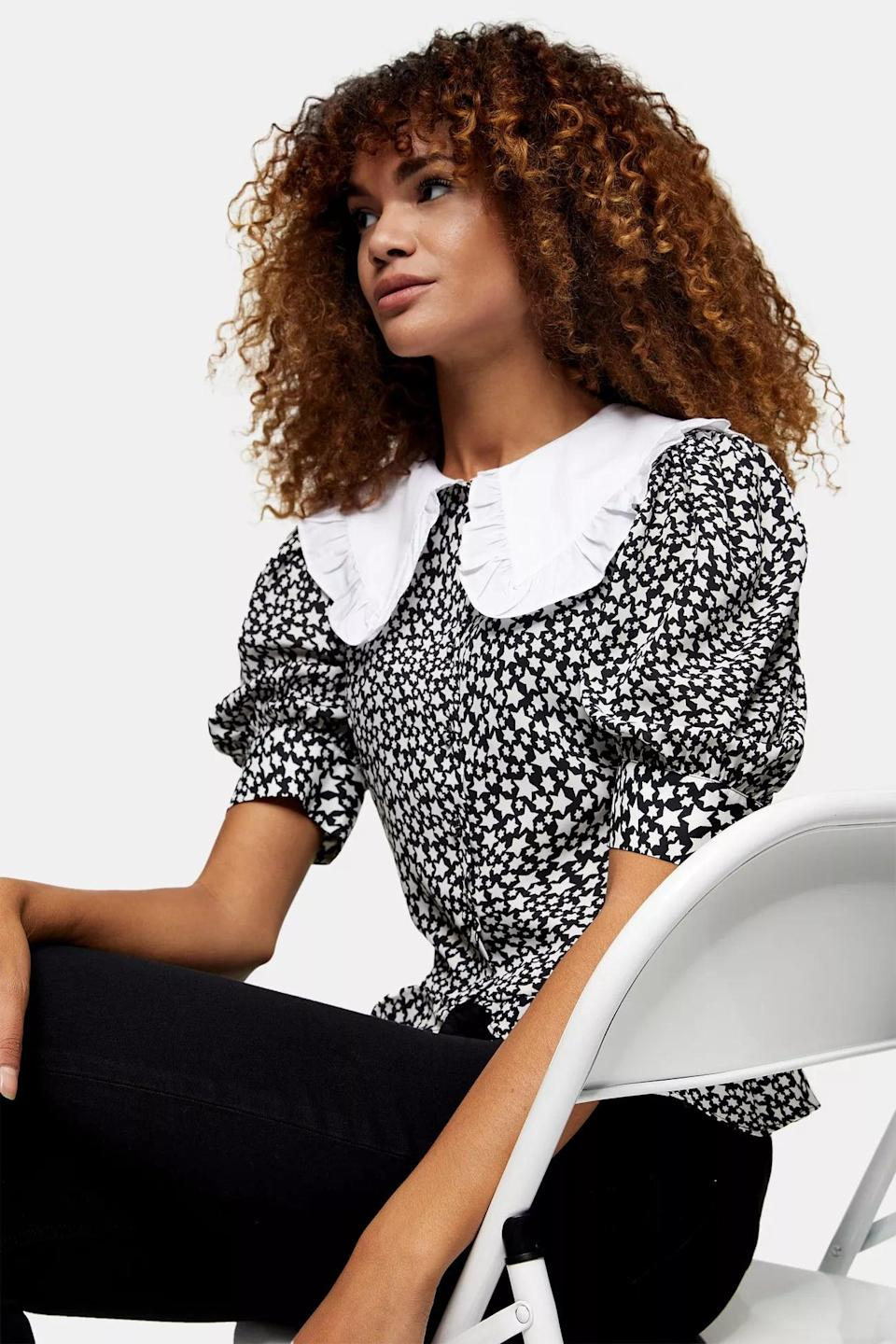 <p>This <span>Black and White Constrast Collar Star Top</span> ($58) is so dainty and polished.</p>