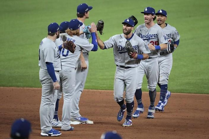Arlington, Texas, Thursday October 8, 2020. Chris Taylor, Cody Bellinger and Mookie Betts celebrate.