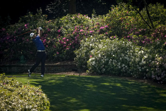 Hideki Matsuyama, of Japan, watches his tee shot on the 13th hole during a practice round for the Masters golf tournament on Tuesday, April 6, 2021, in Augusta, Ga. (AP Photo/Gregory Bull)