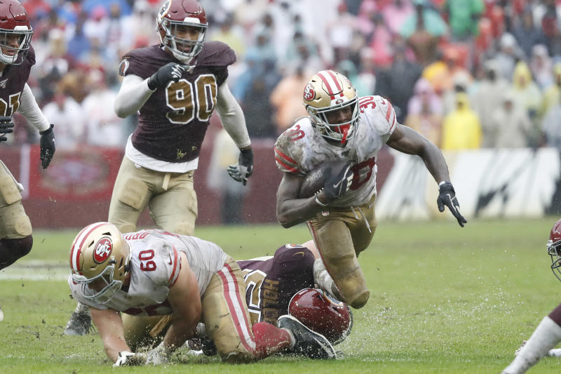 Oct 20, 2019; Landover, MD, USA; San Francisco 49ers running back Jeff Wilson (30) is tackled by Washington Redskins linebacker Cole Holcomb (55) while carrying the ball in the fourth quarter at FedExField. Mandatory Credit: Geoff Burke-USA TODAY Sports