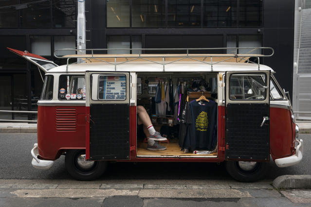 Bruce McCullough, who moved to Japan 22 years ago from Vancouver, Canada, sits in his mobile clothing store in the Shibuya district of Tokyo, May 29, 2019. (AP Photo/Jae C. Hong)