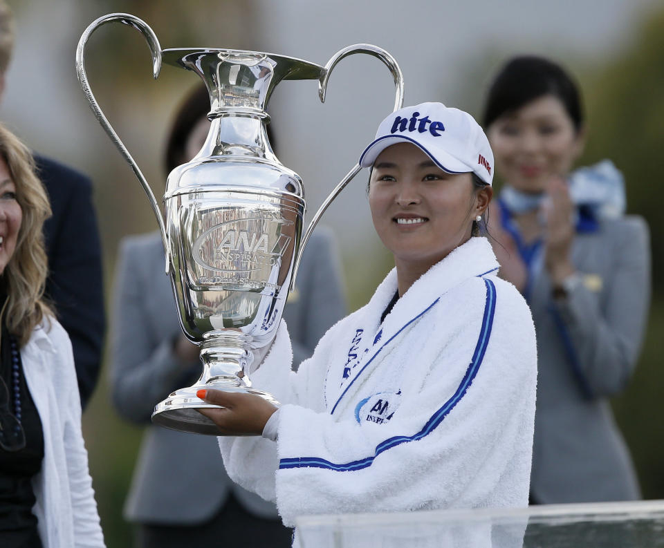 FILE - Jin Young Ko, of South Korea, poses with the Dinah Shore Trophy after winning the LPGA Tour ANA Inspiration golf tournament at Mission Hills Country Club in Rancho Mirage, Calif., in this Sunday, April 7, 2019, file photo. The tournament has a new sponsor in Chevron and plans to move to Houston in 2023. (AP Photo/Alex Gallardo, File)