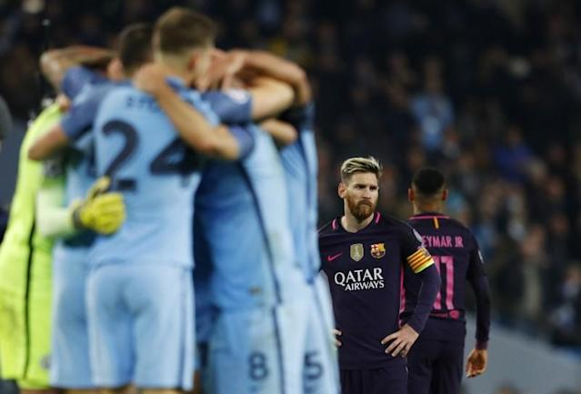 Messi's look says it all as Man City players celebrate a 3-1 win over Barca. (Reuters)