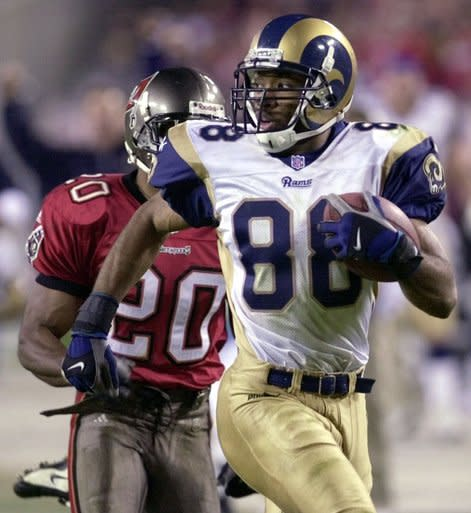 FILE - In this Dec. 18, 2000, file photo, St. Louis Rams wide receiver Torry Holt outruns Tampa Bay Buccaneers cornerback Ronde Barber (20) on a 73-yard touchdown reception during the fourth quarter of an NFL football game at Raymond James Stadium in Tampa, Fla. Holt was selected as a finalist for the Pro Football Hall of Fame's class of 2021 on Tuesday, Jan. 5, 2021.(AP Photo/Chris O'Meara, File)