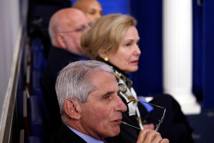 Dr. Deborah Birx, White House coronavirus response coordinator, and Dr. Anthony Fauci, director of the National Institute of Allergy an Infectious Diseases, listen as President Trump speaks at a White House briefing in April.