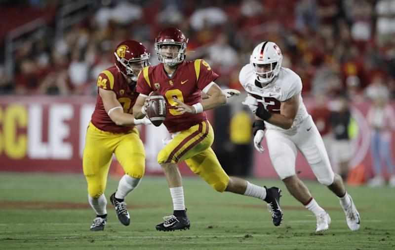 Southern California quarterback Kedon Slovis (9) carries against Stanford during the first half of an NCAA college football game Saturday, Sept. 7, 2019, in Los Angeles. (AP Photo/Marcio Jose Sanchez)