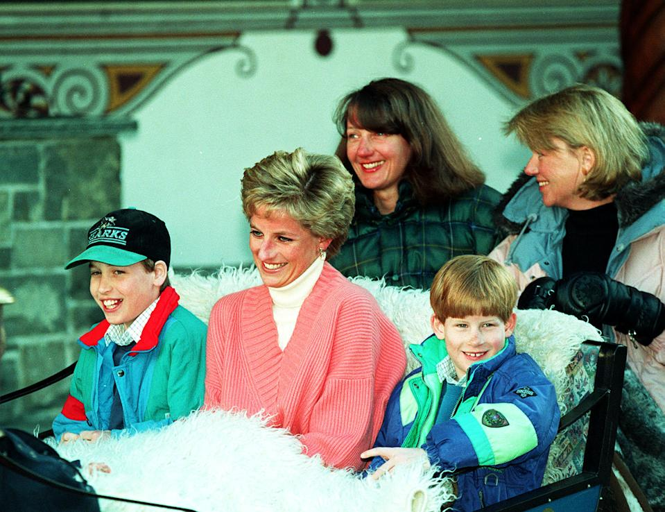 The Princess of Wales and her two sons, Princess William (left) and Prince Harry, ride in a horse-drawn sleigh as they leave their hotel in Lech, Austria. They are accompanied by the Princess's friends Catherine Soames and Kate Menzies
