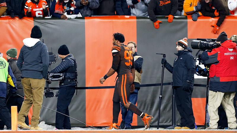 Seen here, Myles Garrett walks off after being ejected over the incident.
