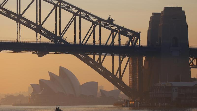 A thick haze has covered Sydney with smoke from nearby bushfires drifting across the city
