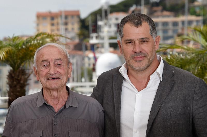 "French scientist Claude Lorius (L) and French director Luc Jacquet pose during a photocall for the film ""Ice and the Sky"" at the 68th Cannes Film Festival in Cannes, southeastern France on May 23, 2015. (AFP Photo/Loic Venance)"