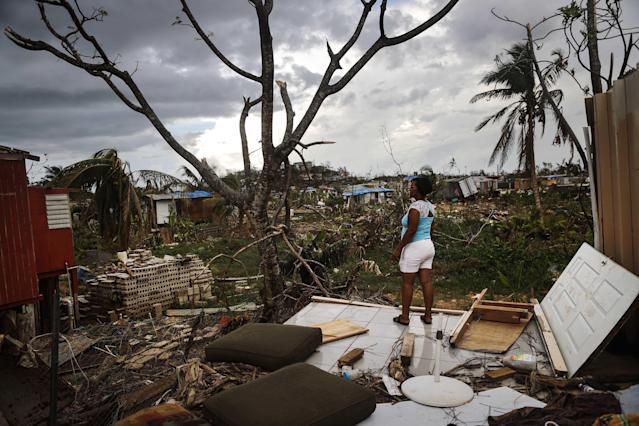 <p>Resident Mirian Medina stands on her property about two weeks after Hurricane Maria swept through the island on Oct. 5, 2017 in San Isidro, Puerto Rico. Residents in her section of the town remain without grid power or running water. Puerto Rico experienced widespread damage including most of the electrical, gas and water grid as well as agriculture after Hurricane Maria, a category 4 hurricane, swept through. (Photo: Mario Tama/Getty Images) </p>