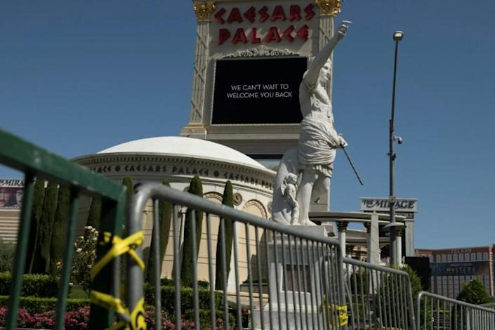 The entrance to Caesars Palace Hotel and Casino is barricaded (AFP Photo/Bridget BENNETT)