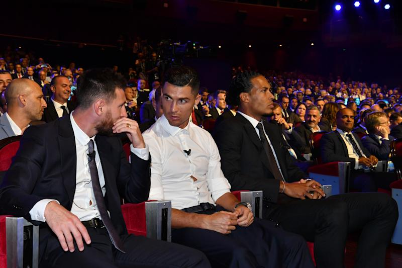 MONACO, MONACO - AUGUST 29: Cristiano Ronaldo of Juventus speaks to Lionel Messi of FC Barcelona during the UEFA Champions League Draw, part of the UEFA European Club Football Season Kick-Off 2019/2020 at Salle des Princes, Grimaldi Forum on August 29, 2019 in Monaco, Monaco. (Photo by Harold Cunningham - UEFA/UEFA via Getty Images)