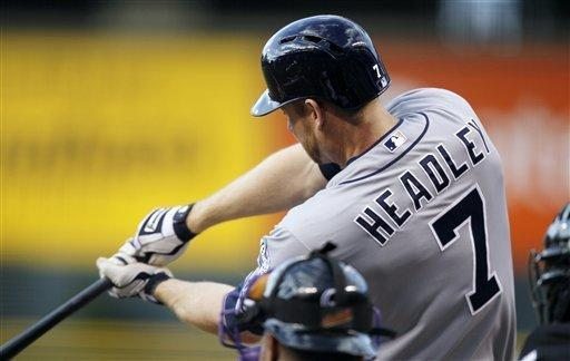 San Diego Padres' Chase Headley connects for a solo home run off Colorado Rockies starting pitcher Juan Nicasio in the first inning of a baseball game in Denver on Wednesday, April 18, 2012. (AP Photo/David Zalubowski)